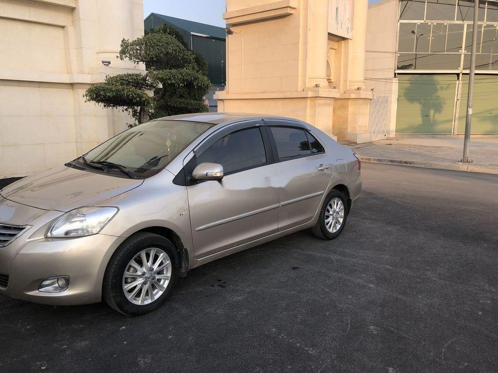 Cần bán xe Toyota Vios 1.5E MT 2013, màu vàng cát, số sàn (2)