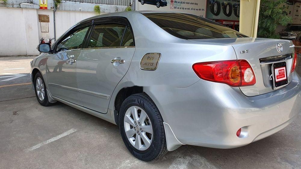 Cần bán gấp Toyota Corolla Altis 1.8AT sx 2009, màu bạc (4)
