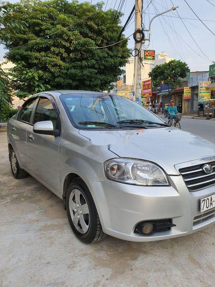 Cần bán lại xe Daewoo Gentra MT 2009, màu bạc xe gia đình (1)