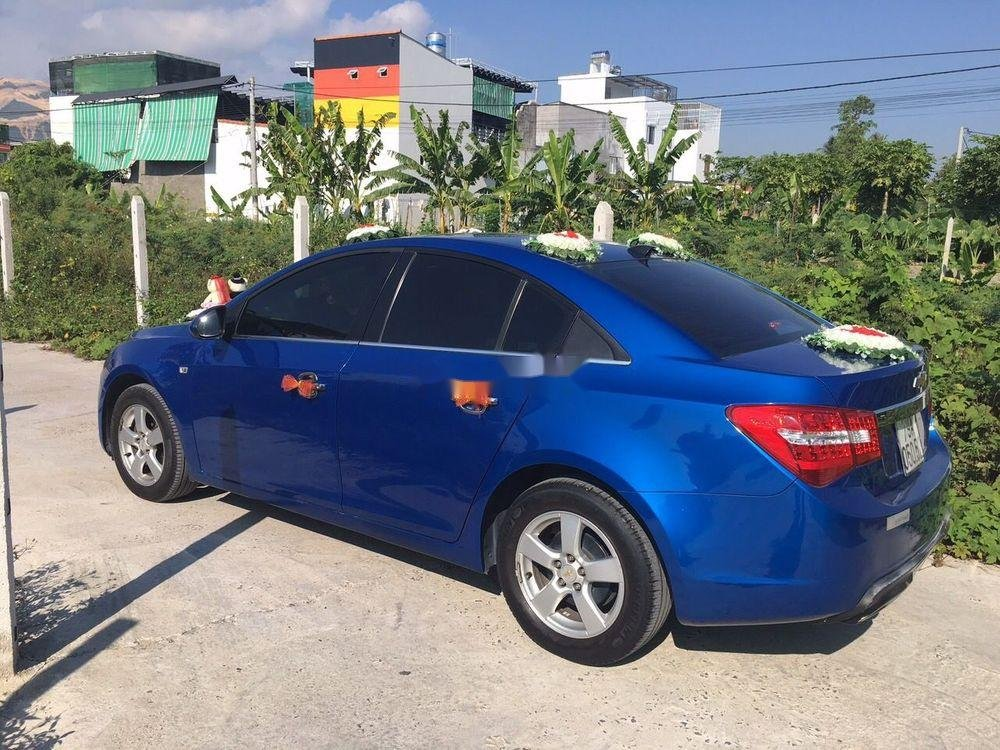 Cần bán Chevrolet Cruze đời 2011, màu xanh lam chính chủ xe nguyên bản (1)