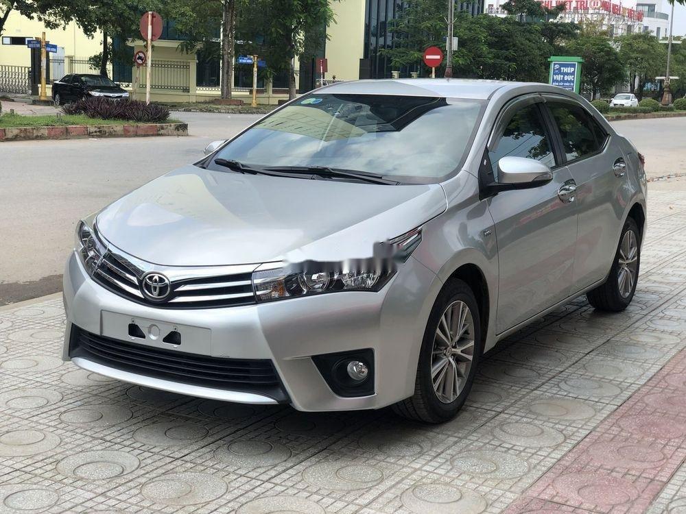Cần bán gấp Toyota Corolla Altis đời 2016, màu bạc xe gia đình, xe nguyên bản (1)