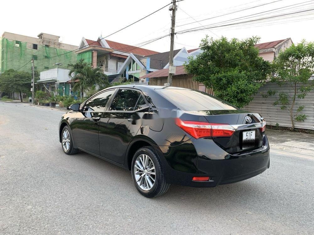 Cần bán gấp Toyota Camry 1.8GAT đời 2015, màu đen (6)