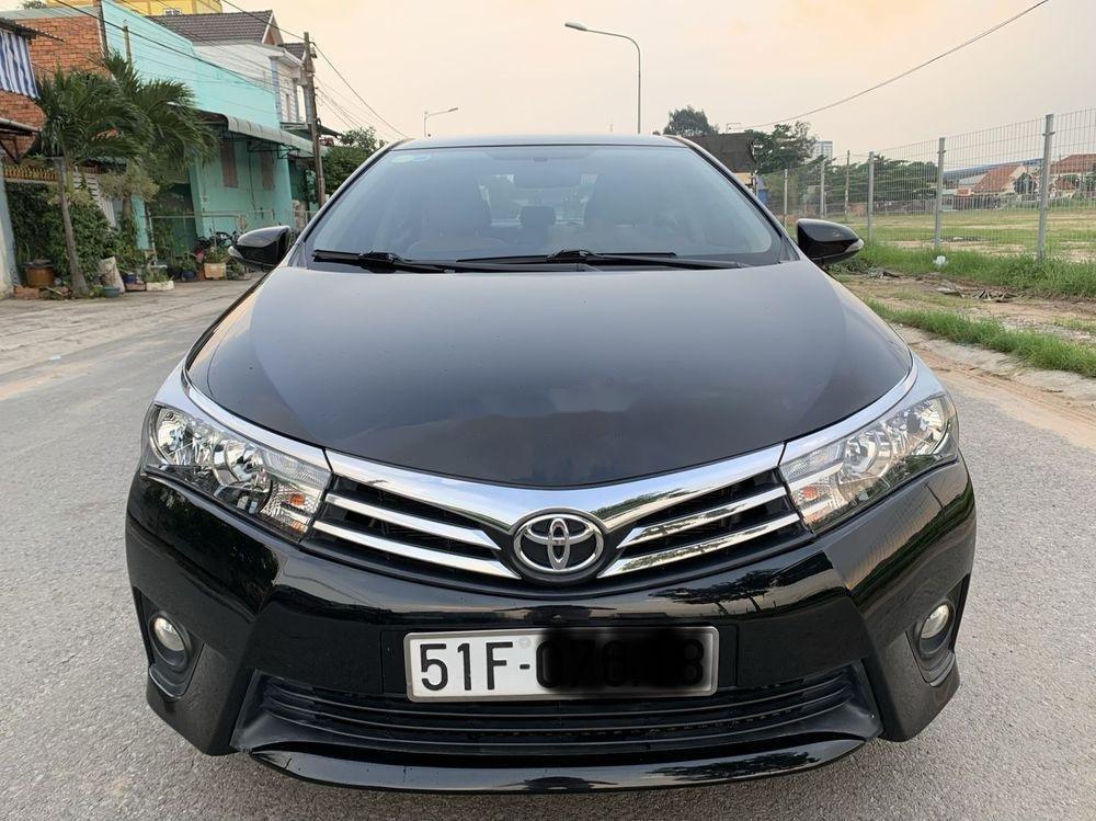 Cần bán gấp Toyota Camry 1.8GAT đời 2015, màu đen (1)