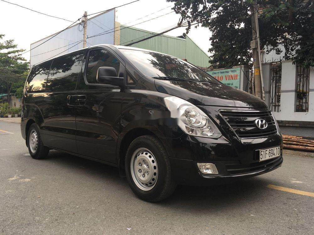 Bán Hyundai Grand Starex đời 2016, màu đen xe gia đình xe nguyên bản (3)