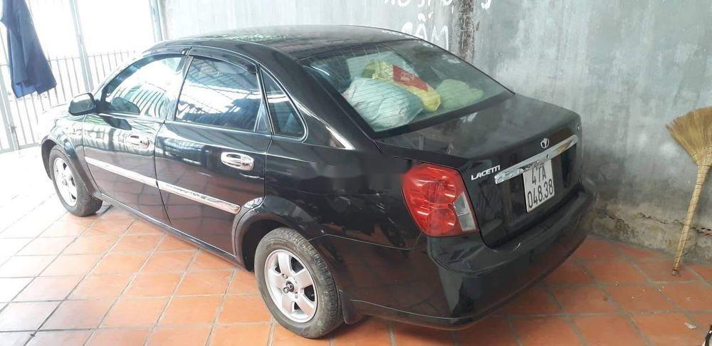 Cần bán Daewoo Lacetti năm 2010, màu đen xe gia đình xe nguyên bản (1)