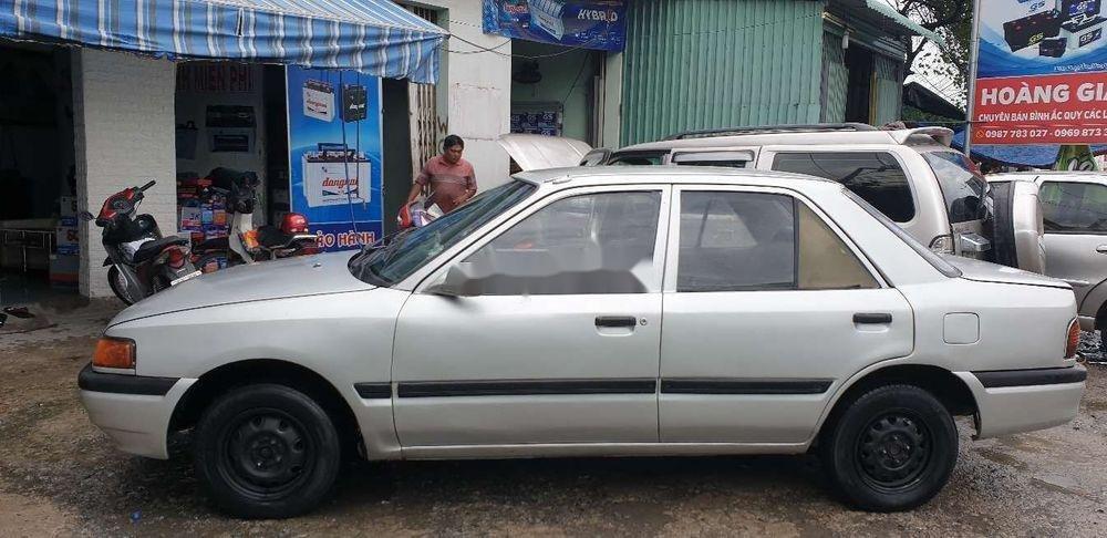 Chính chủ bán Mazda 323 đời 1995, màu bạc, máy chất (2)
