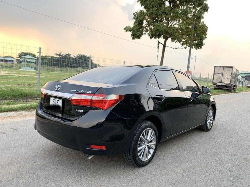 Cần bán gấp Toyota Camry 1.8GAT đời 2015, màu đen (5)