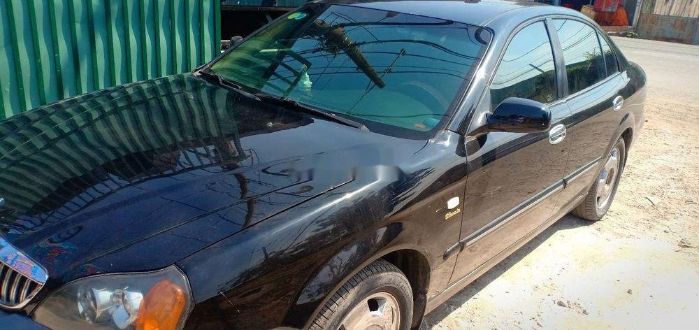 Cần bán lại xe Daewoo Magnus sản xuất năm 2005, màu đen xe gia đình xe nguyên bản (2)