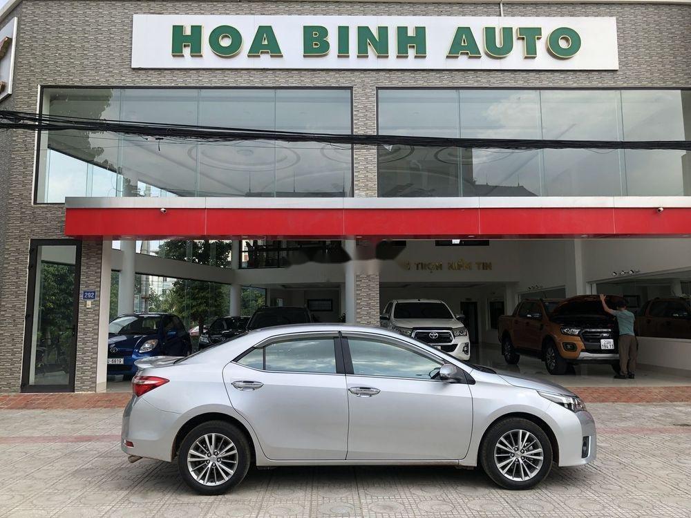 Cần bán gấp Toyota Corolla Altis đời 2016, màu bạc xe gia đình, xe nguyên bản (6)
