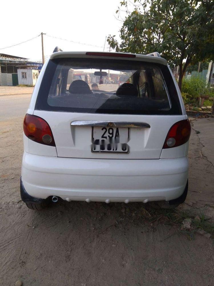 Cần bán Daewoo Matiz đời 2004, màu trắng xe gia đình xe nguyên bản (1)