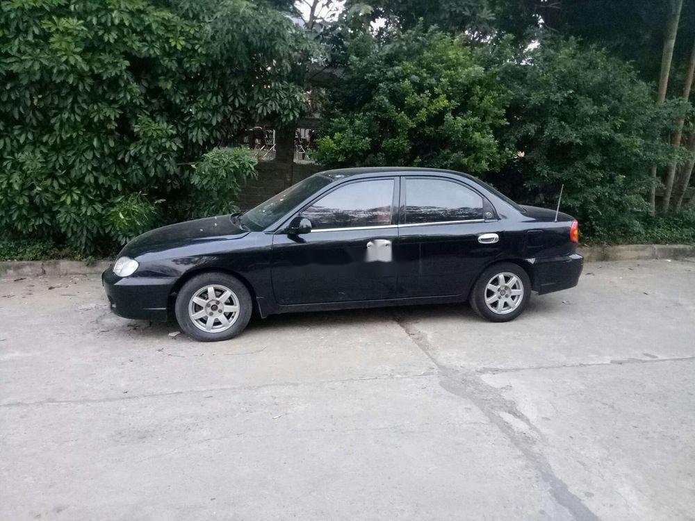 Cần bán xe Kia Spectra sản xuất năm 2004, màu đen, giá tốt (2)