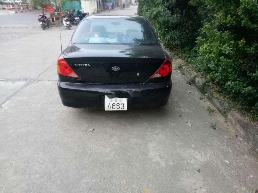 Cần bán xe Kia Spectra sản xuất năm 2004, màu đen, giá tốt (3)