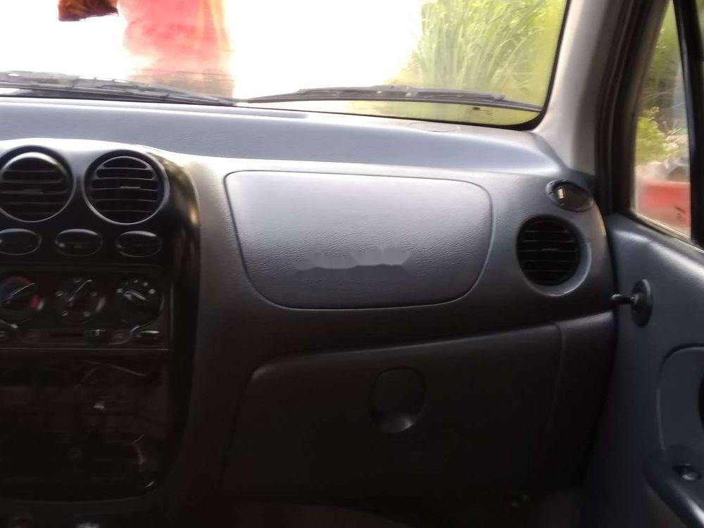 Cần bán Daewoo Matiz đời 2004, màu trắng xe gia đình xe nguyên bản (2)