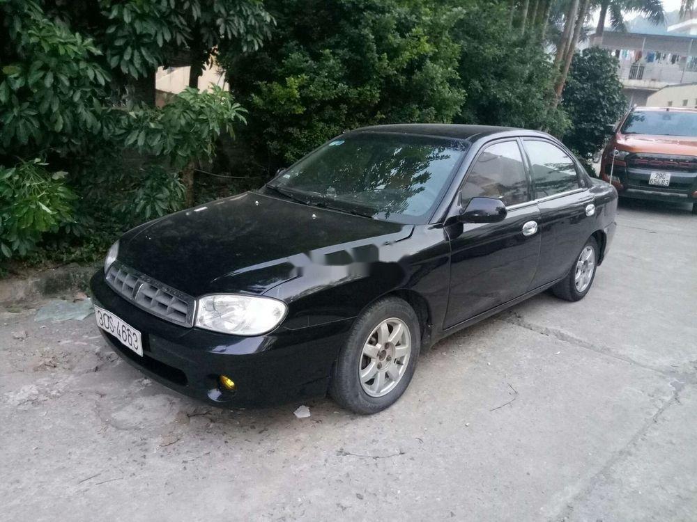 Cần bán xe Kia Spectra sản xuất năm 2004, màu đen, giá tốt (1)