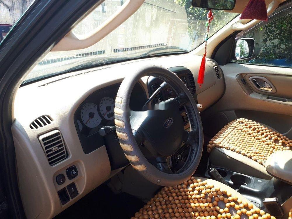 Cần bán Ford Escape năm sản xuất 2004, màu đen, nhập khẩu chính hãng. (4)
