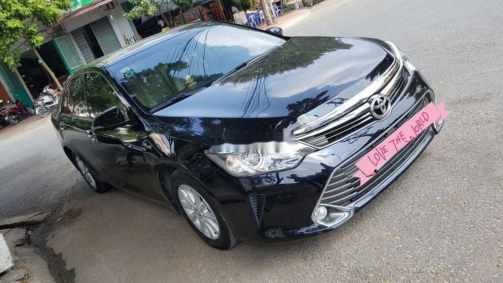 Cần bán gấp Toyota Camry AT 2016, màu đen (1)