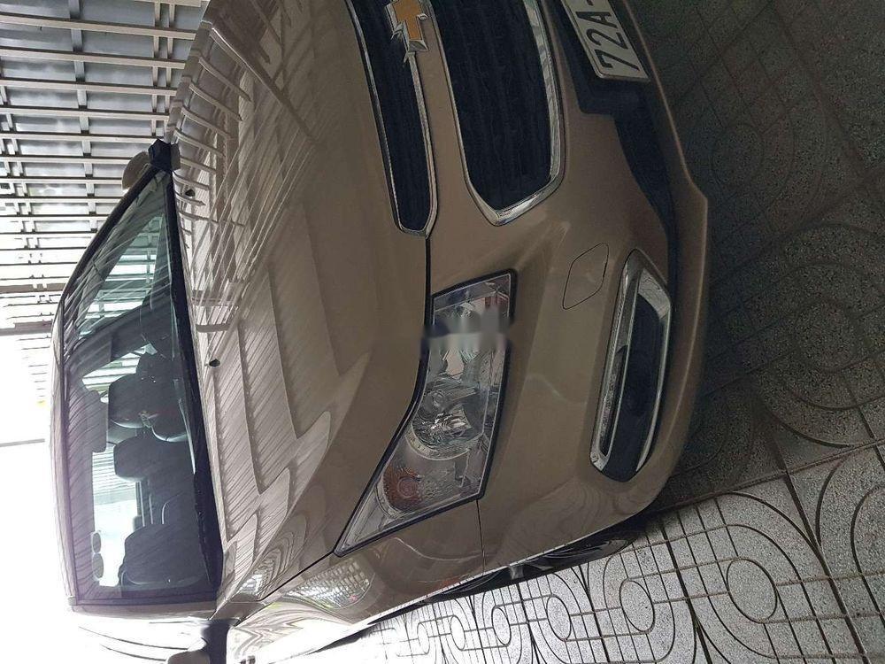 Cần bán Chevrolet Cruze đời 2016, màu vàng, xe gia đình (1)
