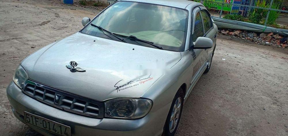 Cần bán gấp Kia Spectra 2004, màu bạc xe nguyên bản (10)