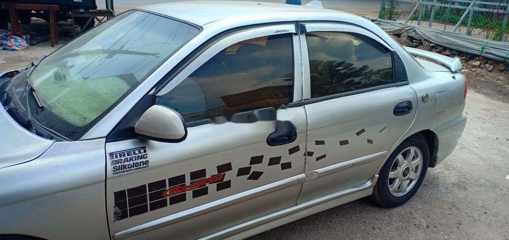 Cần bán gấp Kia Spectra 2004, màu bạc xe nguyên bản (9)