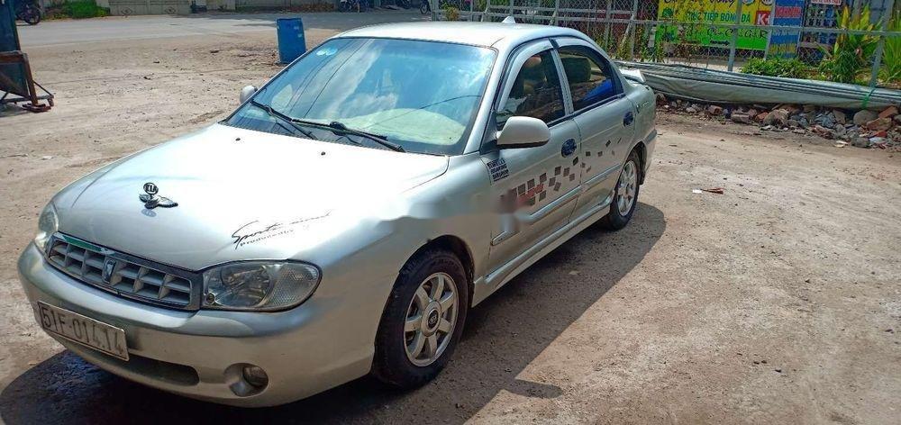 Cần bán gấp Kia Spectra 2004, màu bạc xe nguyên bản (3)