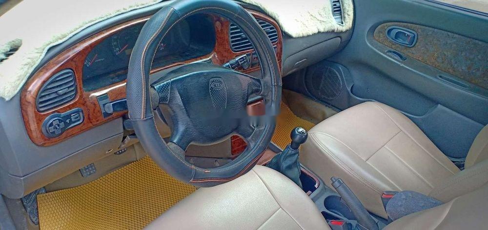 Cần bán gấp Kia Spectra 2004, màu bạc xe nguyên bản (7)
