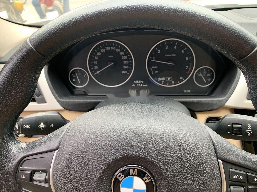 Cần bán xe BMW 320i đời 2016, màu trắng, xe nhập (12)