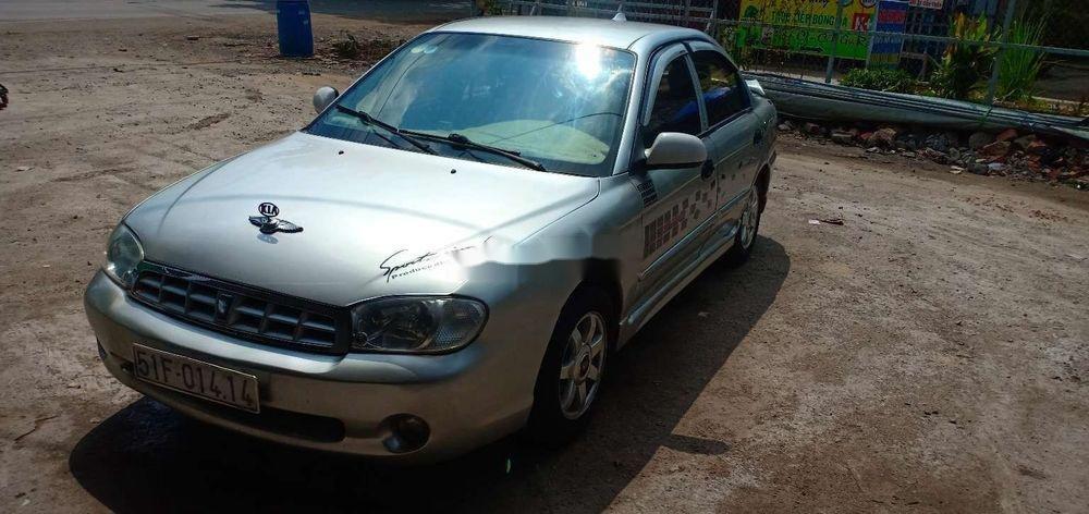 Cần bán gấp Kia Spectra 2004, màu bạc xe nguyên bản (5)