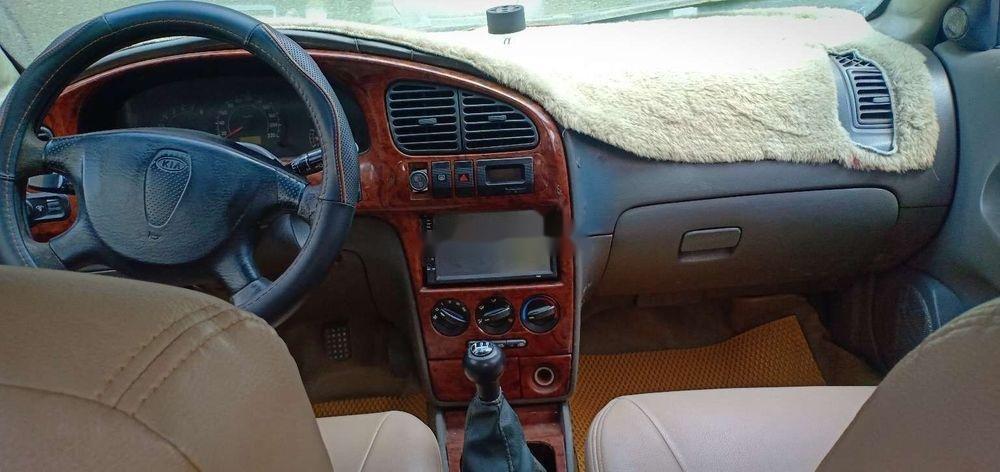 Cần bán gấp Kia Spectra 2004, màu bạc xe nguyên bản (6)