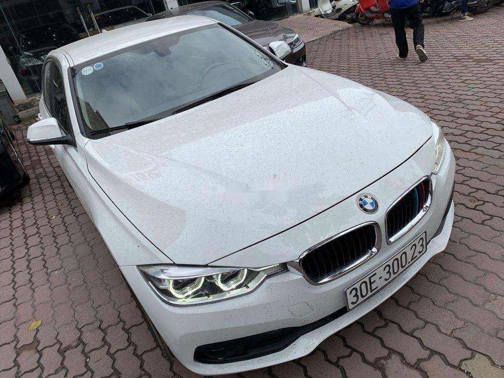 Cần bán xe BMW 320i đời 2016, màu trắng, xe nhập (4)