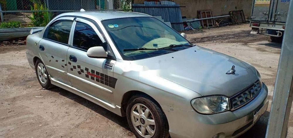 Cần bán gấp Kia Spectra 2004, màu bạc xe nguyên bản (1)
