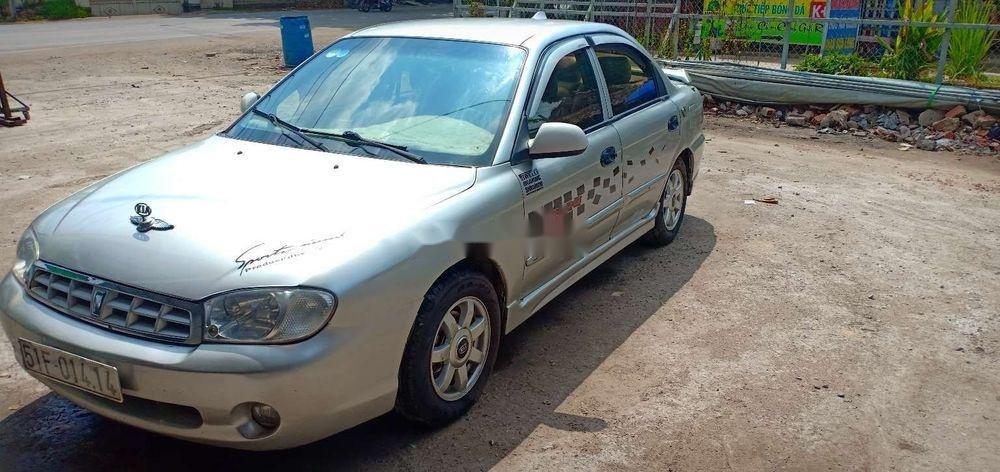 Cần bán gấp Kia Spectra 2004, màu bạc xe nguyên bản (4)