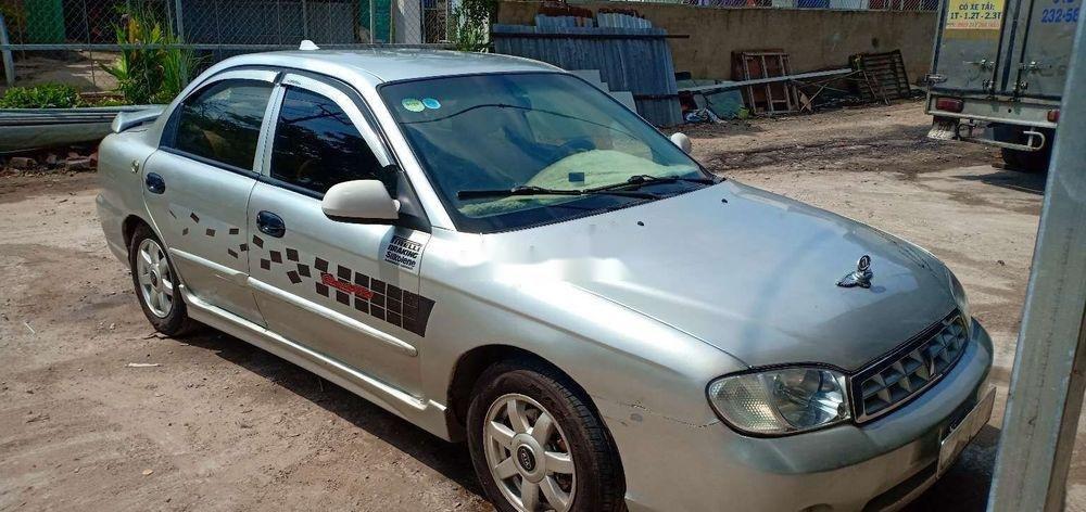Cần bán gấp Kia Spectra 2004, màu bạc xe nguyên bản (2)