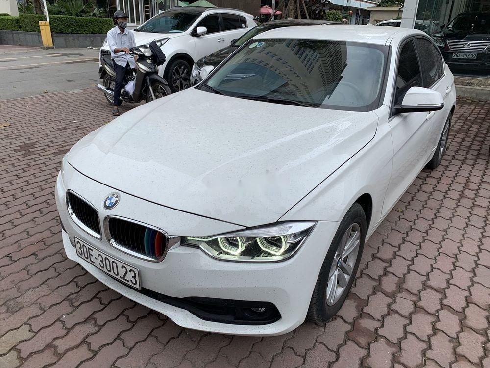 Cần bán xe BMW 320i đời 2016, màu trắng, xe nhập (1)