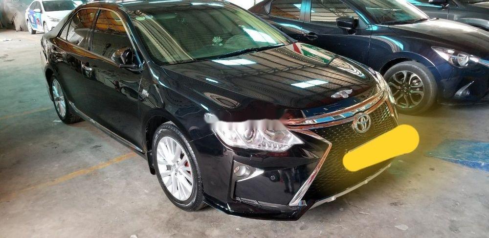 Cần bán gấp Toyota Camry đời 2016, màu đen xe nguyên bản (2)