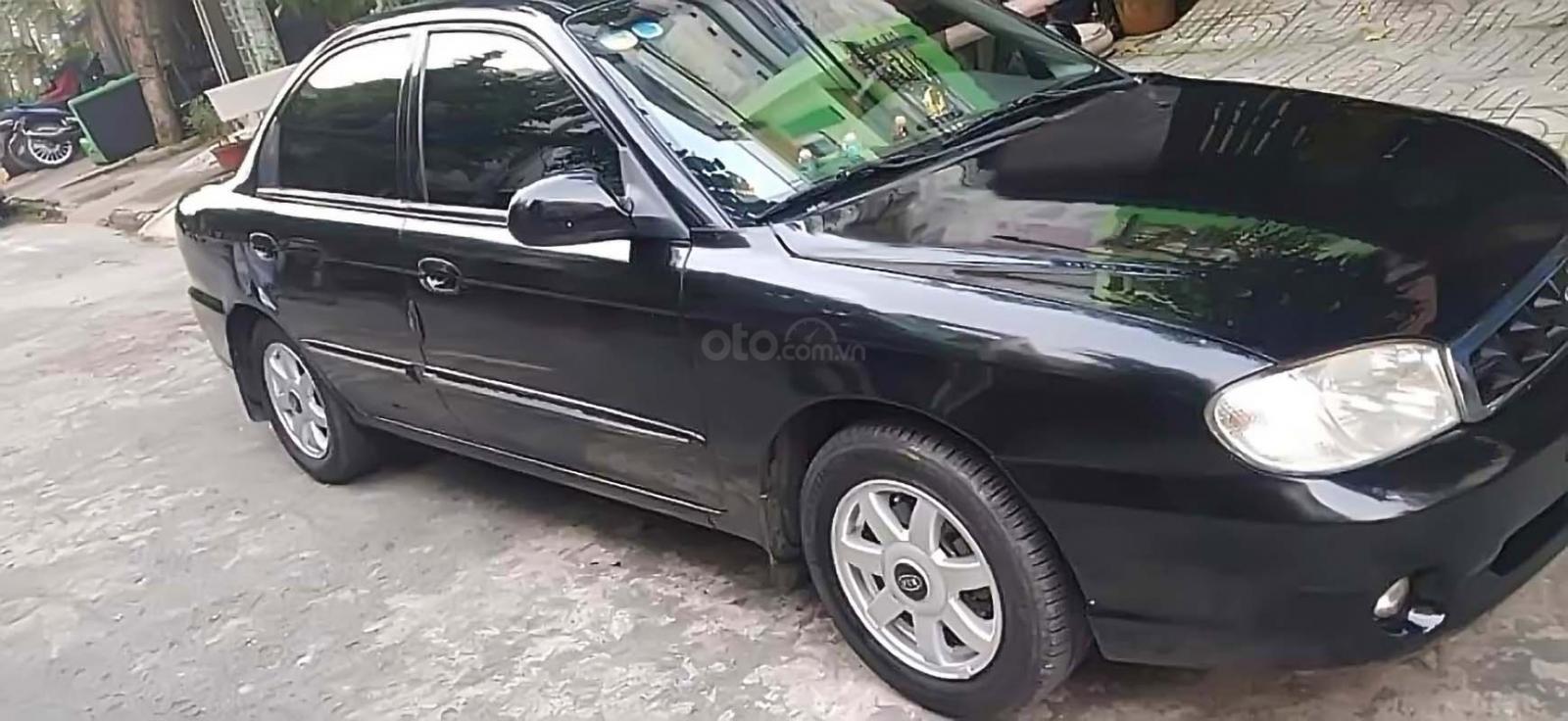 Bán xe Kia Spectra đời 2003, màu đen, nhập khẩu nguyên chiếc, giá 160tr (1)