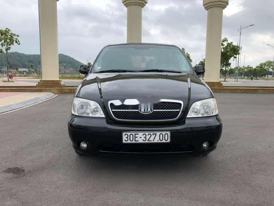 Xe Kia Carnival năm 2009, màu đen, xe nhập còn mới, giá tốt (1)