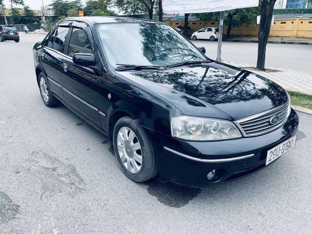Bán ô tô Ford Laser đời 2004, màu đen còn mới (2)
