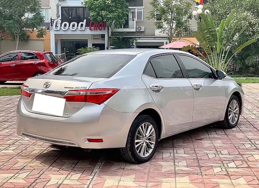 Bán xe Toyota Corolla Altis đời 2014, màu bạc số tự động, 569 triệu xe nguyên bản (3)