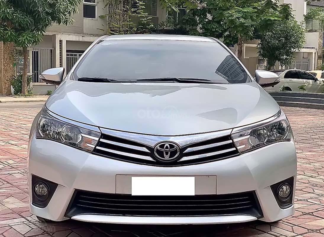 Bán xe Toyota Corolla Altis đời 2014, màu bạc số tự động, 569 triệu xe nguyên bản (4)