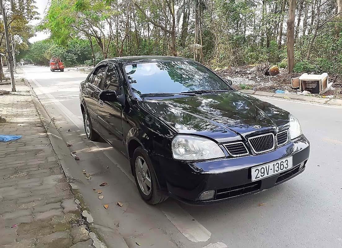 Bán xe Daewoo Lacetti đời 2004, màu đen, xe còn mới (1)