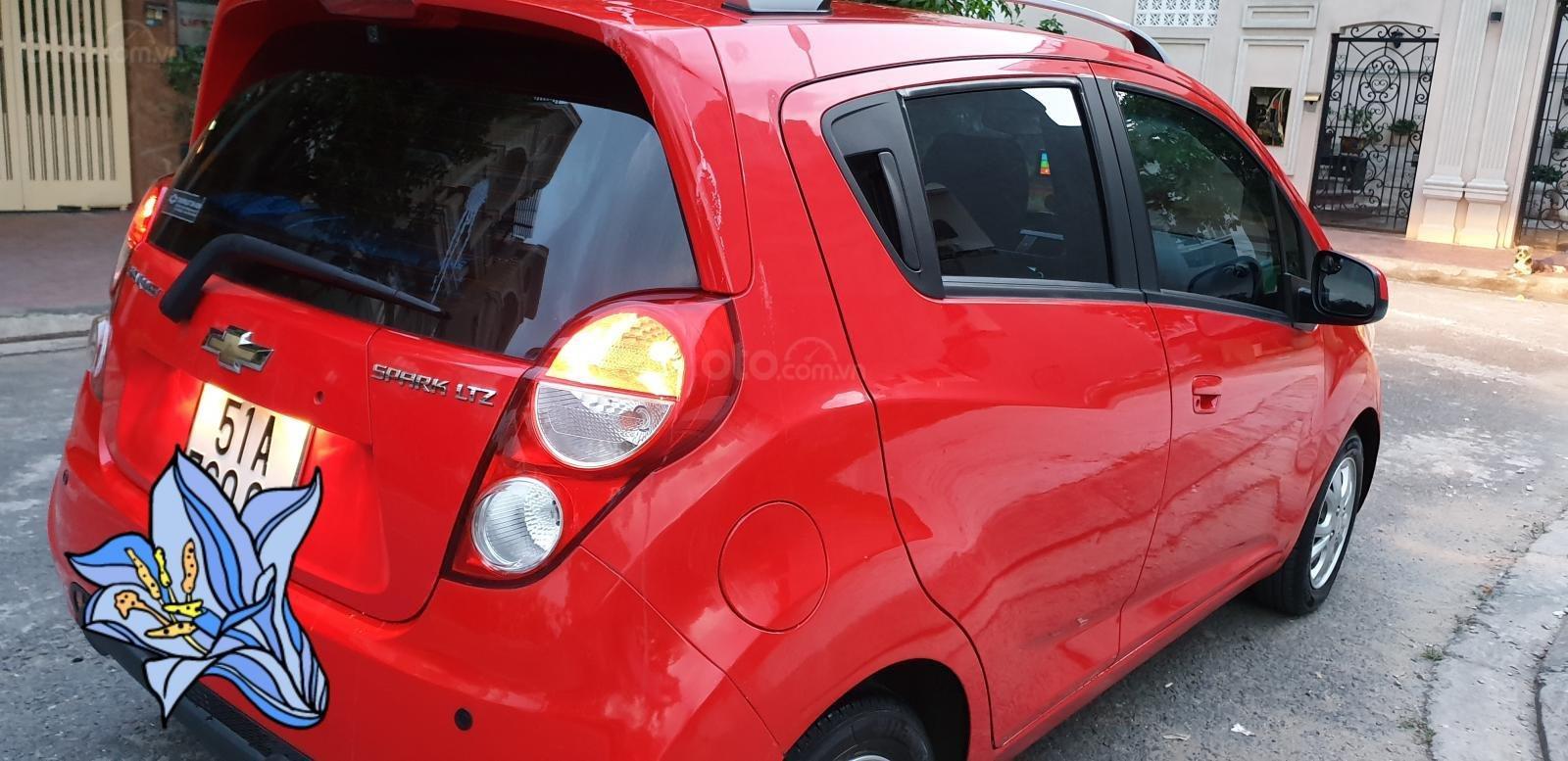 Bán Chevrolet Spark LTZ , số tự động đời T2/2014 sx 2013 màu đỏ đẹp mới 90% (9)