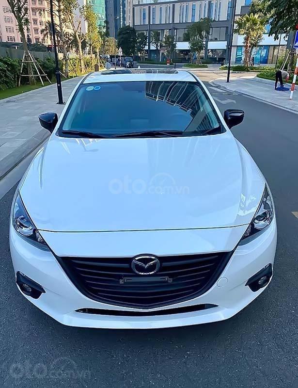 Cần bán xe Mazda 3 đời 2015, màu trắng như mới giá cạnh tranh (1)