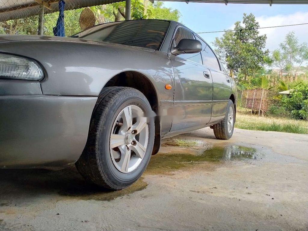 Cần bán gấp Mazda 626 năm sản xuất 1996, màu xám chính chủ, 99 triệu (2)