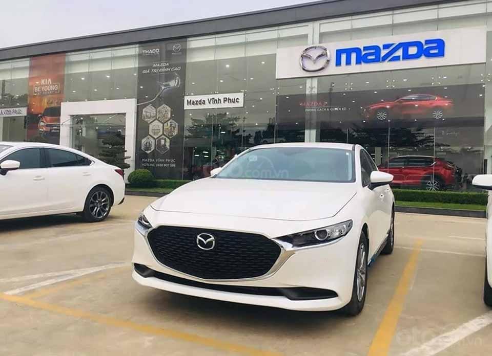 Cần bán Mazda 3 1.5 Deluxe năm 2020, màu trắng, giá 709tr (1)