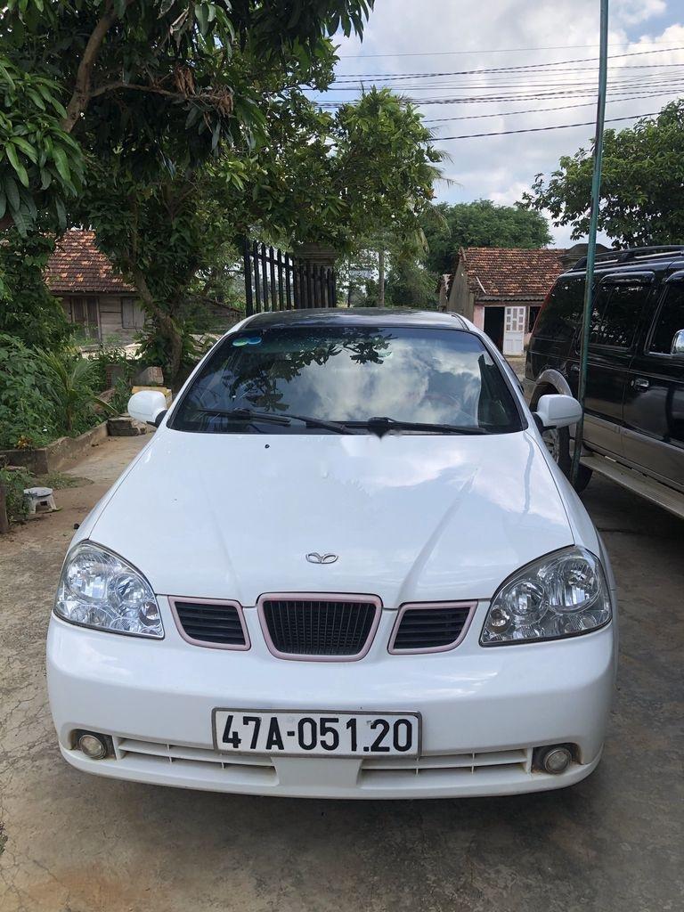 Cần bán Daewoo Lacetti đời 2004, màu trắng xe gia đình giá cạnh tranh (1)