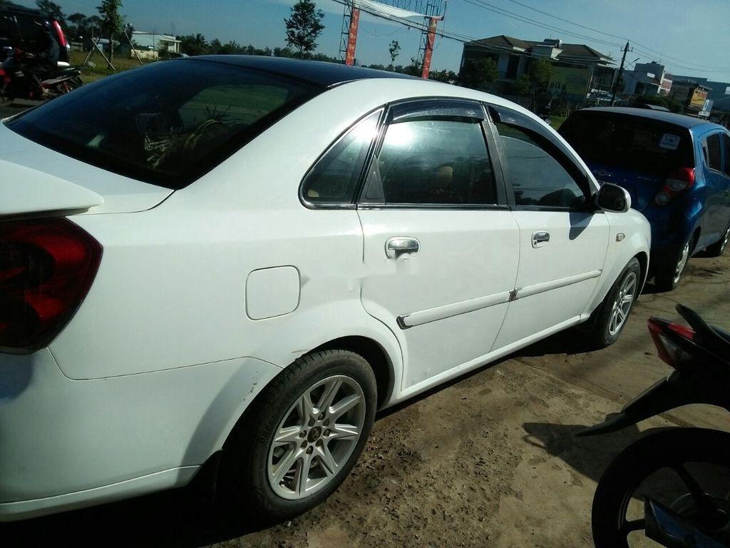 Cần bán Daewoo Lacetti đời 2004, màu trắng xe gia đình giá cạnh tranh (9)