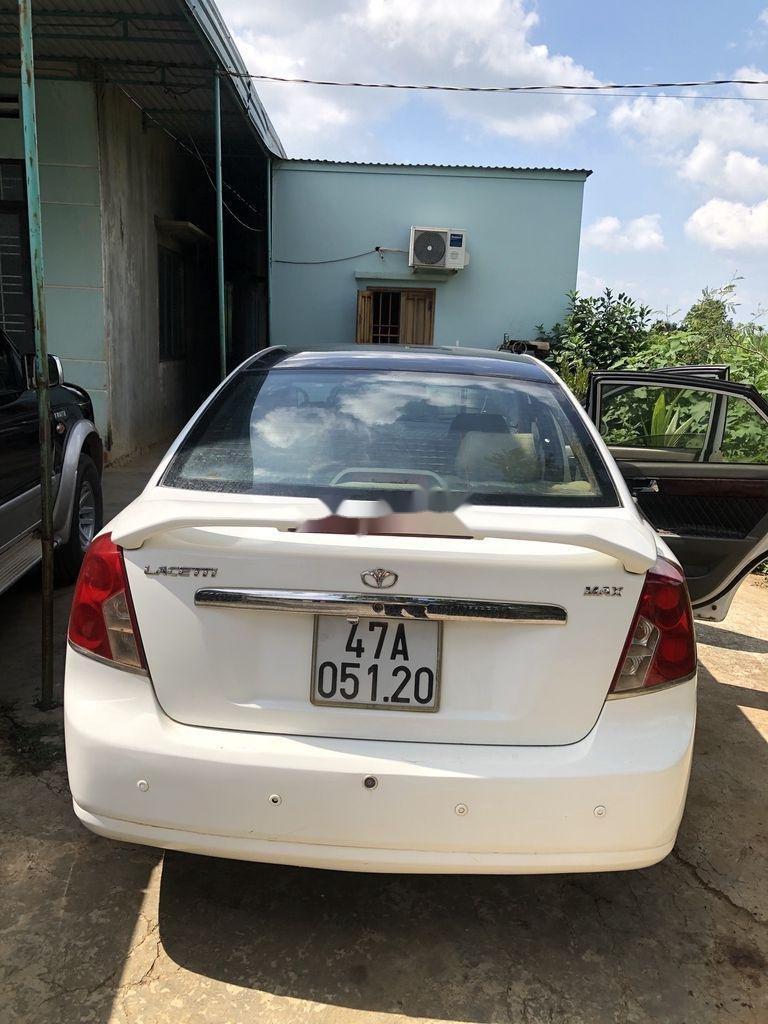 Cần bán Daewoo Lacetti đời 2004, màu trắng xe gia đình giá cạnh tranh (8)