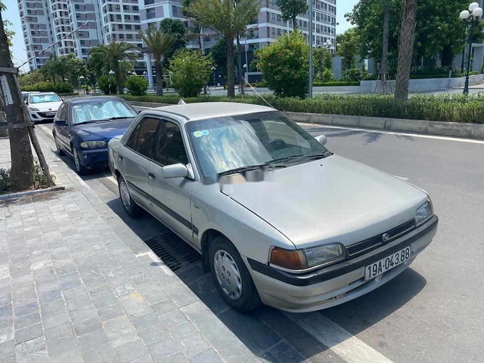Cần bán lại xe Mazda 323 đời 1995, màu bạc, nhập khẩu (1)