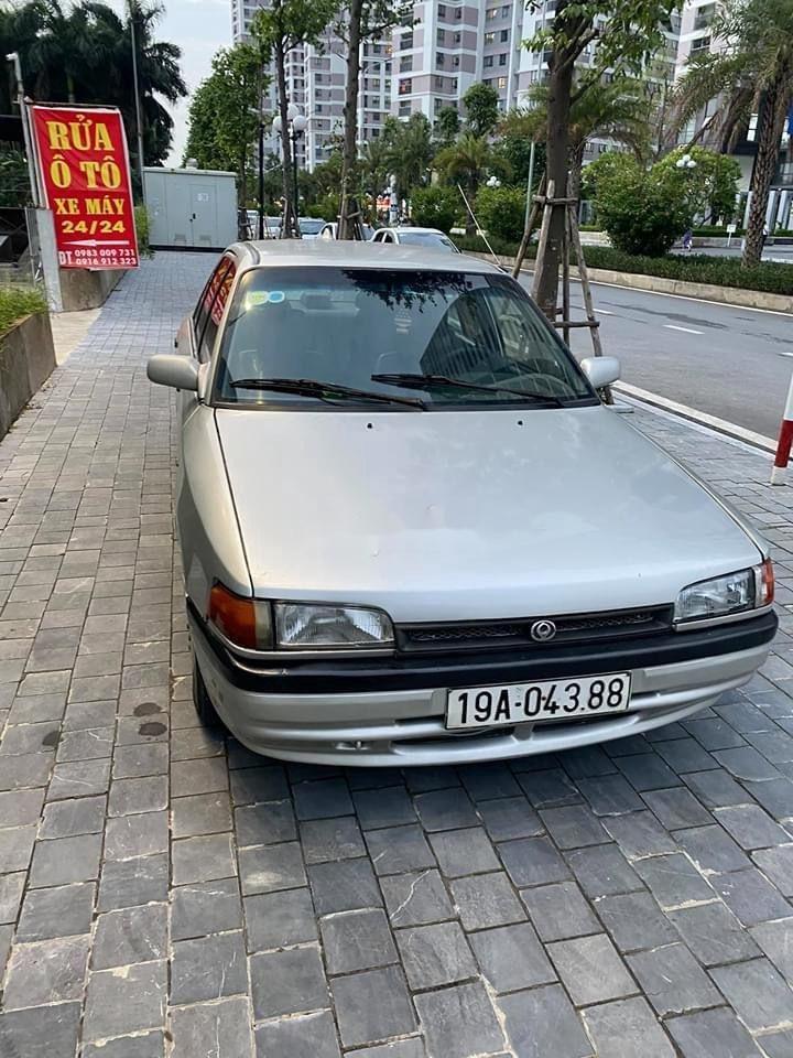 Cần bán lại xe Mazda 323 đời 1995, màu bạc, nhập khẩu (3)