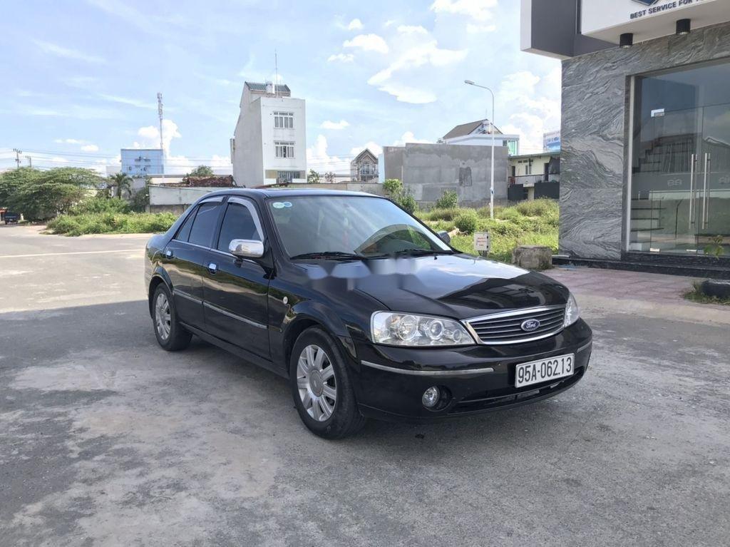 Cần bán xe Ford Laser 2004, màu đen, số tự động (1)